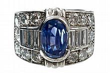 Art Deco-style sapphire and diamond cocktail ring, the wide band with an oval mixed cut Sri Lankan b