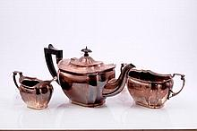 1920s three piece silver tea set, comprising teapot of fluted form with reed and ribbon border, ebon