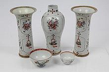 Garniture of three mid-18th century Chinese export vases, comprising an oviform vase and pair of tru