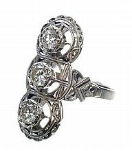 Diamond cocktail ring with three brilliant cut diamonds in fancy white gold setting with bright cut