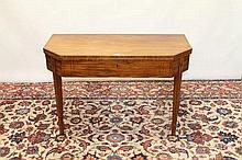 Regency mahogany and ebony line inlaid tea table of canted rectangular form, with hinged top on squa
