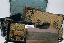 Three cushions incorporating 17th century tapestry fragments, together with other decorative cushion