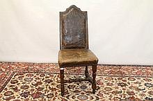 Late 17th century Continental walnut and leather upholstered dining chair, arched high back with tab