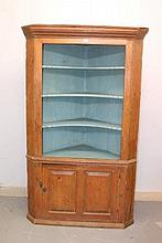 George III pine standing corner cupboard with moulded cornice above shaped open shelves, enclosed by