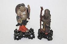 Two Chinese carved and polychrome lacquered figure