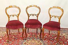 Set of five Victorian mahogany balloon back dining