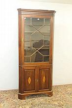 Early 19th century inlaid mahogany corner cupboard