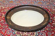 Early 20th century japanned oval wall mirror with