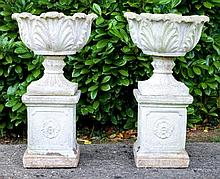 Pair of concrete garden urns of shallow dished for