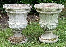 Pair of campagna form concrete garden urns raised