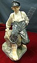 Royal Copenhagen figure of a seated Dutch boy No