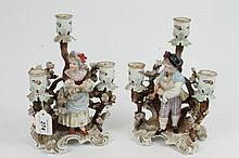 Pair of late 19th century German Sitzendorf porcelain three-branch can