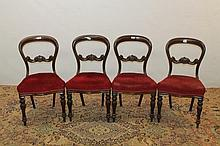 Set of four Victorian mahogany balloon back dining chairs with red uph