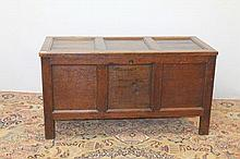 Late 17th century oak coffer with triple panel top and conforming trip