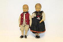 Dolls - pair of Swiss / German carved wood boy and