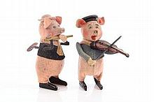 Schuco - tinplate and felt clockwork pigs - one wi