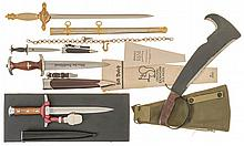 Four Daggers with Scabbards and One Machete with Canvas Cover