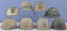 Eight Military Helmets