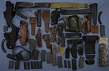 Assortment of Holsters Magazines and Accessories