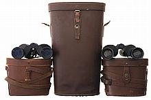 Two Sets of Binoculars with Cases and One Additional Large Carrying Case