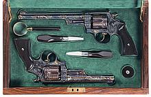 Extraordinary Pair of Relief Carved Cased Exhibition Grade Francolini Master Engraved Gold Inlaid Smith & Wesson Registered Magnum Double Action Revolvers -A) Engraved Gold Inlaid Smith & Wesson Registered Magnum Revolver