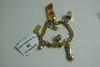 Bracelet articulé en or jaune, les maillons gourmettes supportant en pampille sept breloques diverses (sifflet, brouette...).  Longueur: 17cm.  Poids brut: 41g.