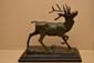 BARYE Antoine-Louis, 1796 -1875 Cerf debout, modèle de 1829 bronze à patine brun clair nuancée de vert (usures), socle en bois noirci, fonte d'édition tardive, sur la terrasse : BARYE et la marque : SUSSE FRES. Ht. : 29 - Lg. : 30,5 cm plus socle.