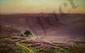 DIDIER-POUGET William, 1864 -1959 Bruyères et falaise au soir huile sur toile rentoilée (petites restaurations), signée en bas à gauche,  58,5 x 92 cm.