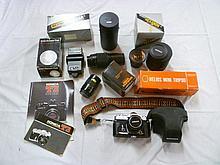 A Konica Auto Reflex T3 camera together with Koni