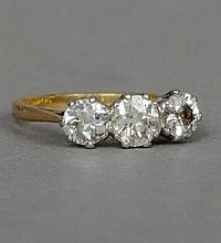 An 18 ct gold and platinum three stone diamond ri