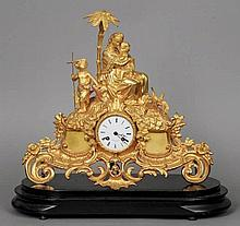 A 19th century gilt  metal mantel clock Surmounte
