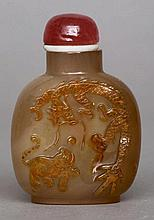 A Chinese carved russet jade snuff bottle Of typi