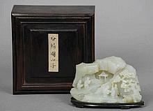 A Chinese carved pale and russet jade scholar's b
