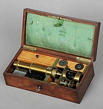A Victorian brass monocular microscope Housed in