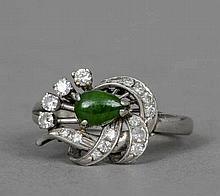An Art Deco diamond and jade set platinum ring