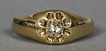 An 18 ct gold gypsy set diamond solitaire ring