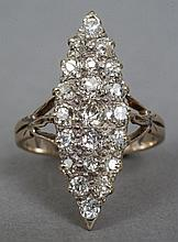 An 18 ct gold diamond cluster ring Of lozenge form, with pierced shoulders.