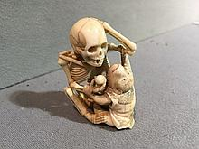 A late 19th century Japanese ivory okimono Intricately carved as a skeleton and a monkey, the underside signed.  5 cm high.