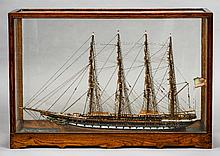 A late 19th century model of a four masted clipper ''The Uncle Sam'' Fully rigged flying the Stars and Stripes, housed in a glazed oak case.  84 cm wide.