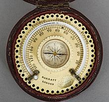 A 19th century carved and pierced ivory pocket thermometer/compass by Marratt of London In original leather case.  6.5 cm diameter.