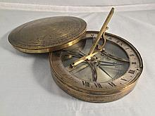 A 19th century lacquered brass cased pocket sundial compass by Spear, Dublin With folding gnomon and signed silvered hour ring with Roman numerals above a glazed engraved silvered compass dial.  9.5 cm diameter.