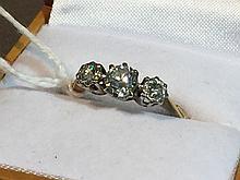 An 18 ct gold diamond three stone ring
