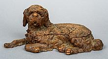 A late 19th century Black Forest carved double inkwell Modelled as a recumbent shaggy dog.  28.5 cm long.