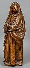 An 18th century carved wood figure of Mary Magdalene, probably Continental Typically worked.  92 cm high.