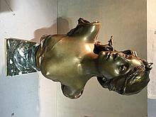 PAUL JEAN BAPTISTE GASQ (1860-1944)  Diane Patinated marble bust, mounted on a marble socle and plinth base 60 cm high
