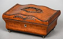 A 19th century satinwood sewing box The hinged serpentine lid inset with polished steel pique decoration.  19 cm wide.