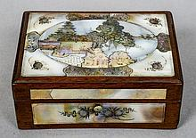 A late 19th/early 20th century Oriental mother-of-pearl mounted wooden box The hinged lid decorated with figures and pagodas amongst a landscape.  9 cm wide.