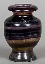A turned fluorite vase Of baluster form.  14.5 cm high.