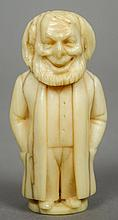 A 19th century carved ivory figure Possibly a Jewish gentleman.  6 cm high.