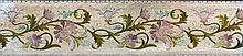 A 19th century needlework panel Worked with flowering acanthus scrolls, framed and glazed.  145 x 34 cm.